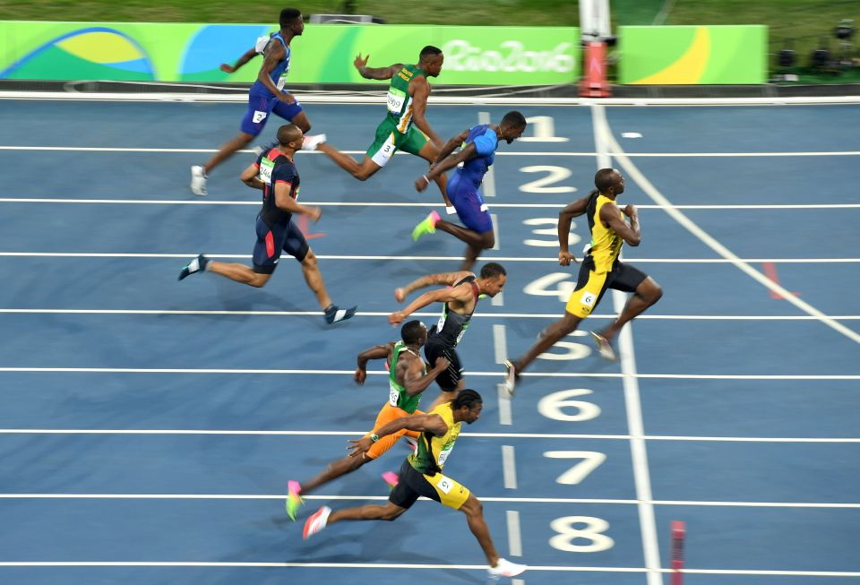 (From bottom) Jamaica's Yohan Blake, Ivory Coast's Ben Youssef Meite, Canada's Andre De Grasse, Jamaica's Usain Bolt, France's Jimmy Vicaut, USA's Justin Gatlin, South Africa's Akani Simbine and USA's Trayvon Bromell cross the finish line of the Men's 100m Final during the athletics event at the Rio 2016 Olympic Games at the Olympic Stadium in Rio de Janeiro on August 14, 2016. / AFP PHOTO / ERIC FEFERBERGERIC FEFERBERG/AFP/Getty Images